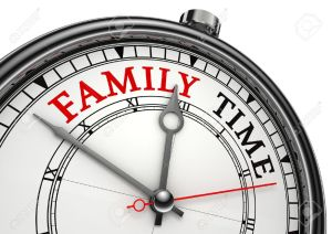 12727918-family-time-concept-clock-closeup-isolated-on-white-background-with-red-and-black-words-stock-photo